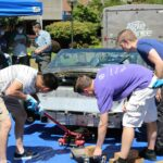 Bellevue College students helping to build a carbon fiber car.