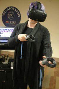 Jessie Martin wearing Hololens VR glasses