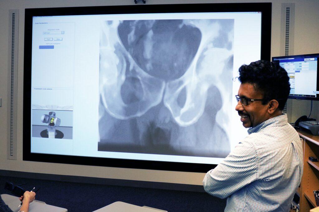 Faculty member standing in front of VERT screen
