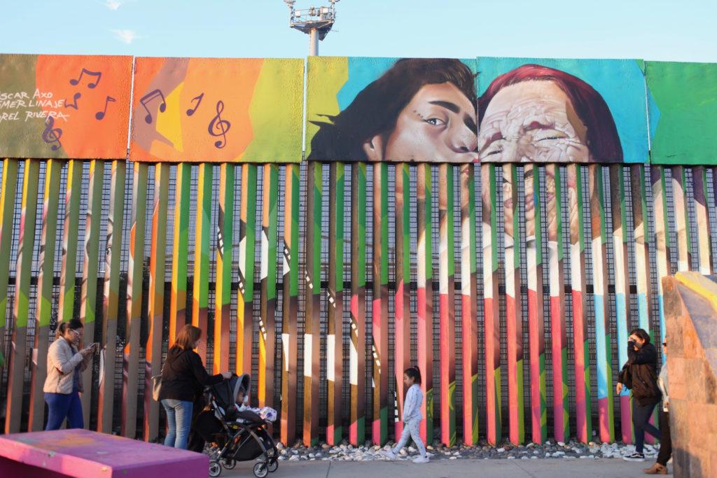 Mural behind the border wall