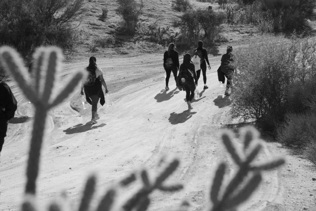 People walking through the California desert