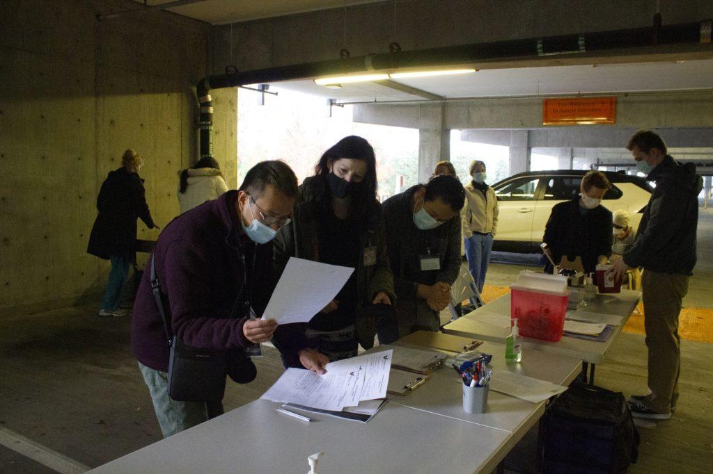 Volunteers gather in the parking garage