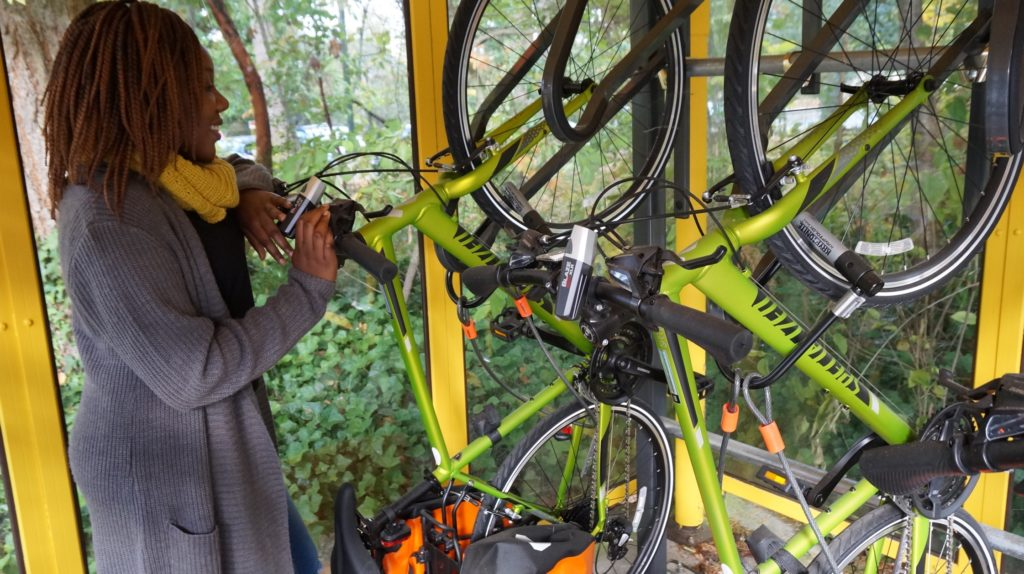 A student checks out one of the bikes for rent