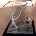 Tree branch with ball sculpture
