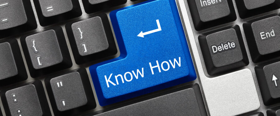 Computer keyboard that says 'Know How' on the return key
