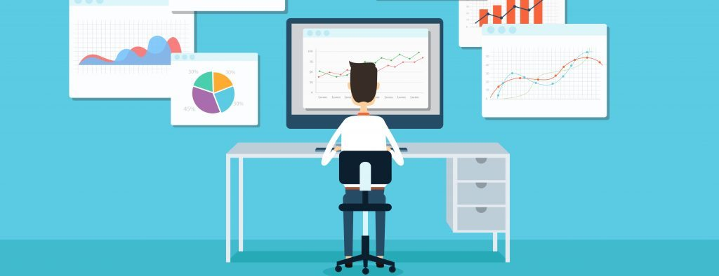 Graphic of person at computer desk in front of data analytics charts
