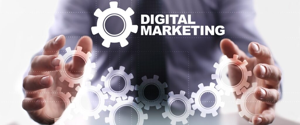 A set of hands around images of gears to indicate digital marketing