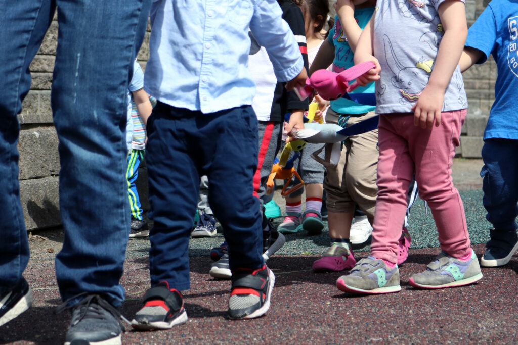 Toddlers walking in a line