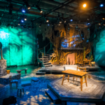 The Admirable Crichton stage set scene with a huge looking tree as part of the set
