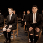 Spring Awakening ...men characters sitting in chairs
