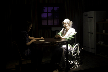 The Shadow Box scene with two woman sitting at table