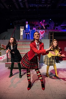 Four teenage girls on stage