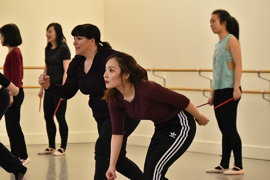 Instructor Laura Peterson dancing with students