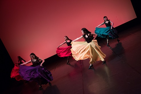 Dance group performing to latin music
