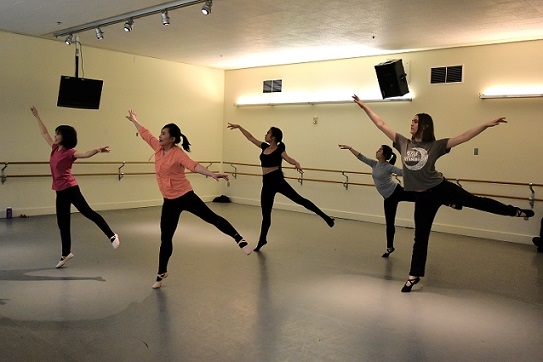 Dance students rehearsing dance moves