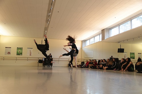 Three students rehearsing their part