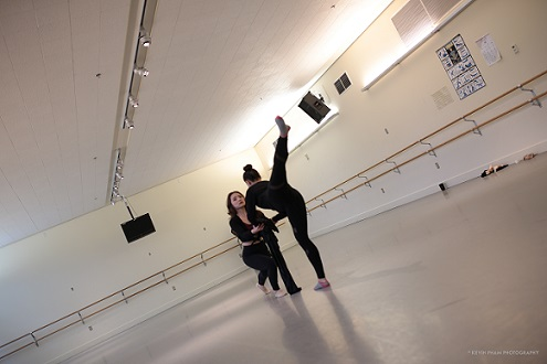 Two dance students practicing their dance moves