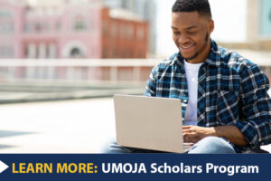 Learn More: Umoja Scholars Program. A Black/African American student on a laptop.