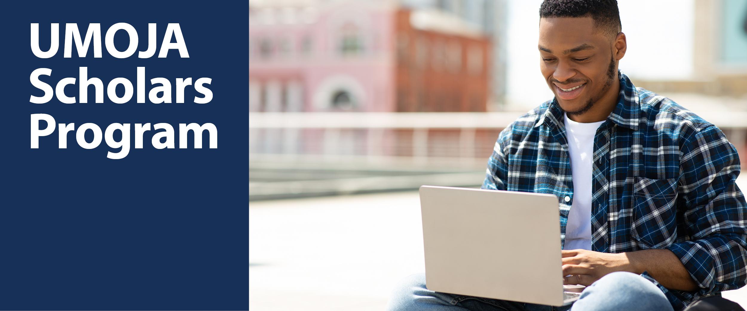 UMOJA Scholars Program. A Black/African American student on a laptop.