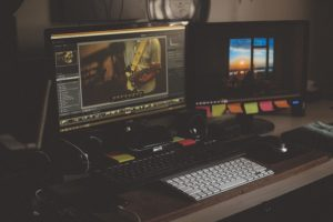desk setup with two computer monitors running visual design programs