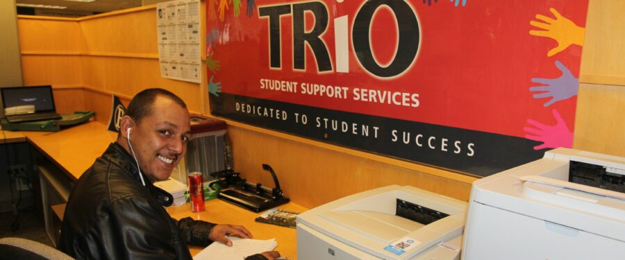 student reading under a banner that says TRiO