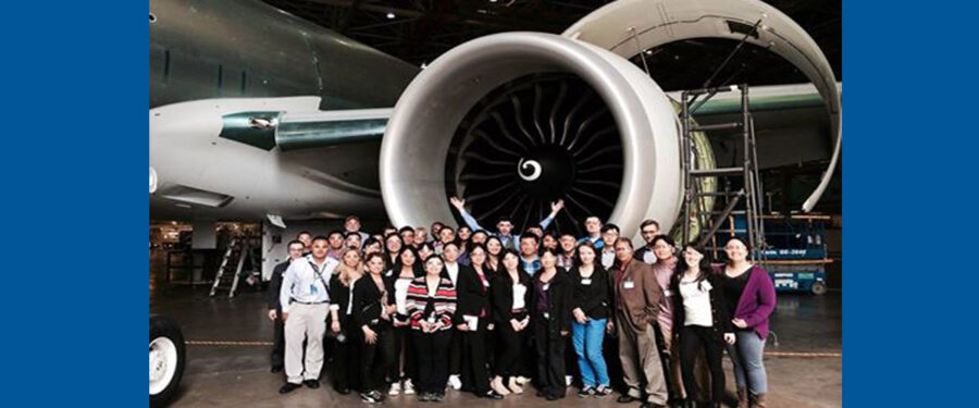 group of students behind the Boeing Plane at the Boeing Field